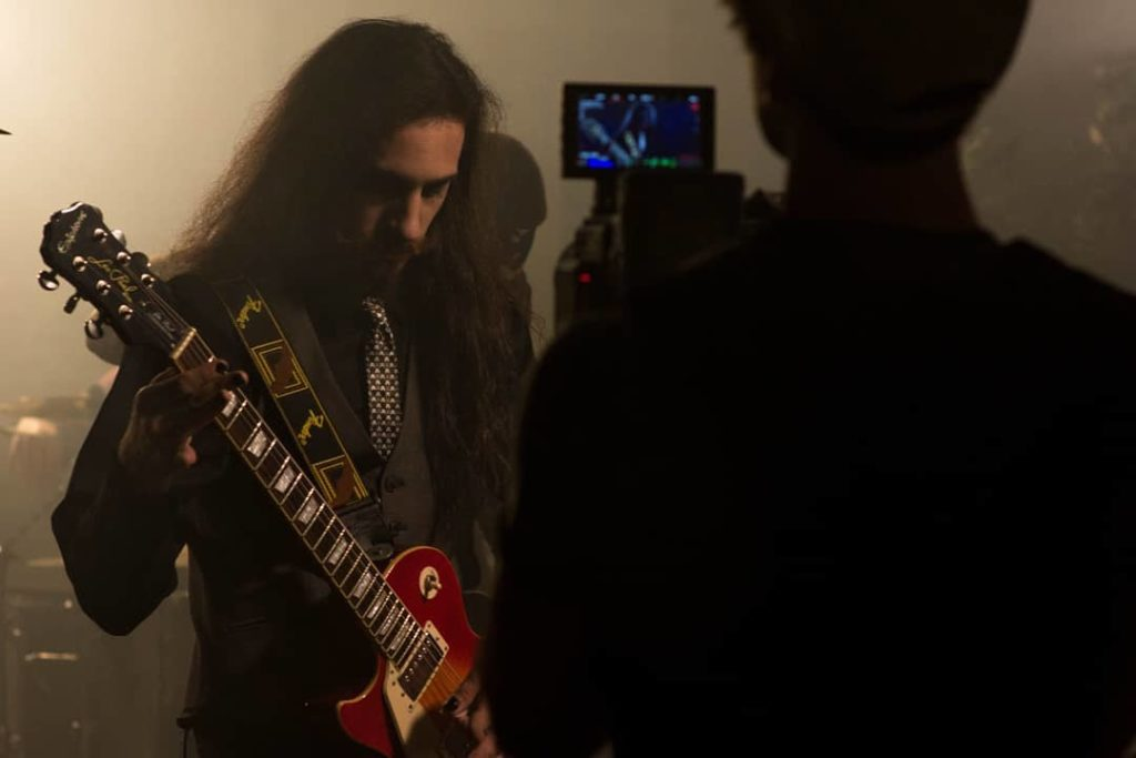 "Dante on guitar.⁣ ⁣Behind the scenes of ""Deliverance"" music video.⁣⁣ Photo: Alek..."